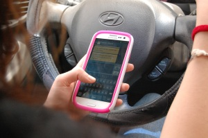 SUN PHOTO ILLUSTRATION Local authorities are trying to educate the public on a  new law will go into effect October 1, which puts a state-wide ban on texting while driving.