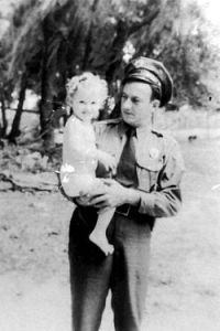 "Simeon ""Simmie"" Moore holding his daughter Frances ""Teenie"" Moore in Madison County, Fla. circa 1937 or 1938. Moore drove an Indian motorcycle and was later Madison County sheriff (1948-1972). Photo: Florida Memory Project."
