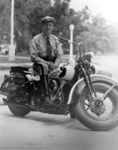 Portrait of Florida Highway Patrolman Bill Norris, graduate of the 1941 patrol school in Lakeland, Florida. He was said to be one of the best riders on the highway patrol and stationed in Orlando, Florida, according to the Florida Memory Project