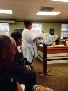 Suzi Fox, executive director of Anna Maria Island Turtle Watch and Shorebird Monitoring, shows Brandenton Beach commissioners remnants of an aerial lantern during their May 22 meeting. Islander photo: Merab-Michal Favorite